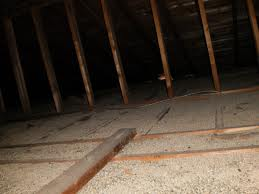 vermiculite insulation mixed with asbestos observed